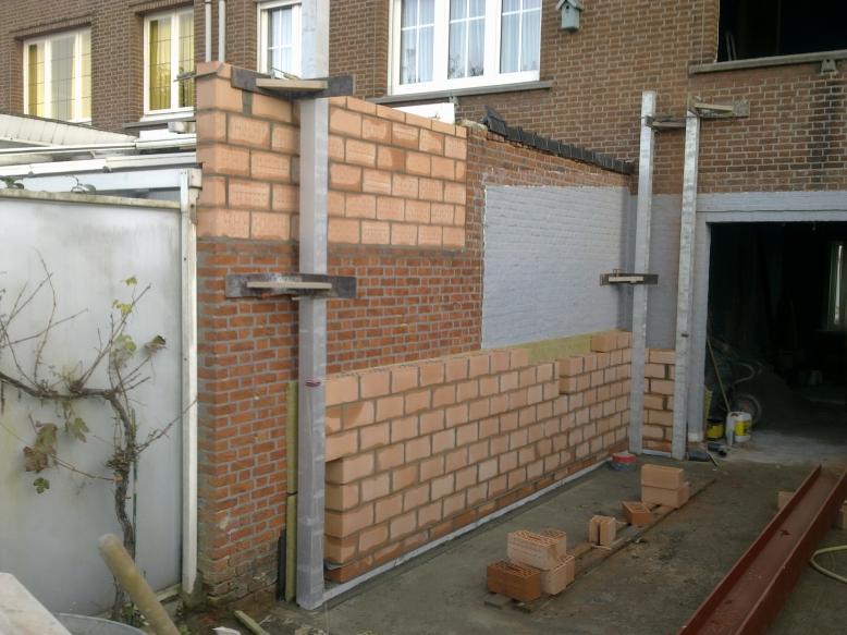 De verbouwing - Veranda met stenen muur ...